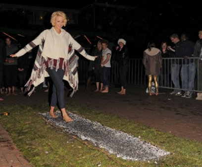 "LONDON, UNITED KINGDOM - NOVEMBER 15: Lydia Bright walks the Fire Walk at ZSL London Zoo to raise money for Tigers on November 15, 2012 in London, England. In A statement, Lydia Bright said: ""I love animals so when I heard London Zoo were doing a fire walk to raise money for tigers I was really keen to take part. I was nervous about walking across hot coals but actually really enjoyed it, and it was for a great cause."" (Photo by Alan Chapman/FilmMagic)"
