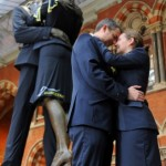 St. Pancras kissing couple dressed in Eurostar uniform