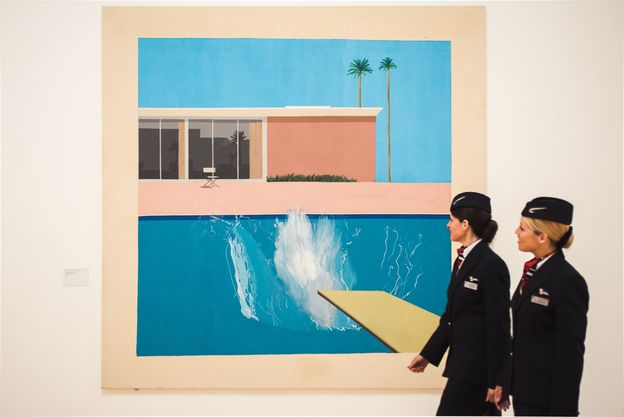 British Airways cabin crew members Janine Clowes and Nicola Sturt admire David Hockneys painting A Bigger Splash