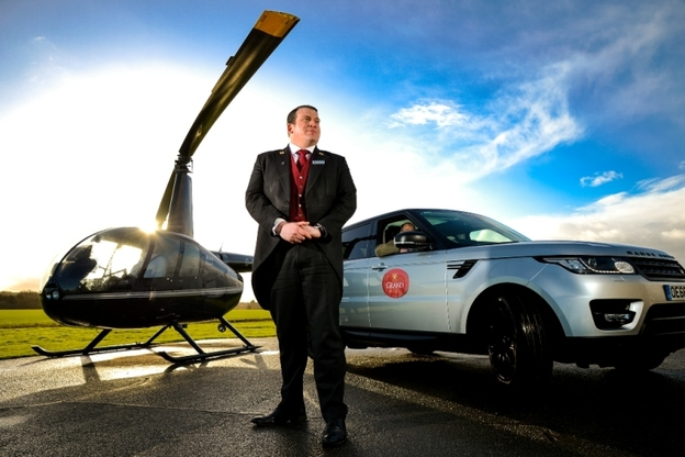 Stewart Reid Head Concierge at The Grand Hotel Spa York launching the hotels new helicopter transfer service 2