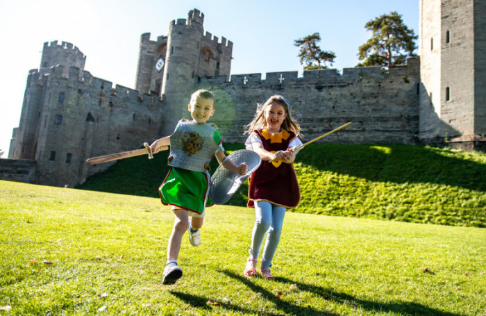 Warwick Castle children playing in front of Castle