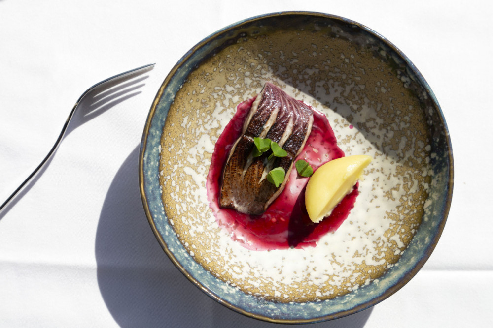 Trout served with a crisp skinserved in a handcrafted bowl